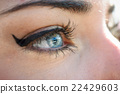 Close-up of young woman's blue eyes with long eyelashes 22429603