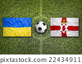 Ukraine vs. Northern Ireland flags on soccer field 22434911