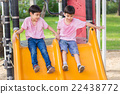 Two little asian boy play slider at playground 22438772