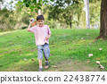 Little sibling boy playing plane paper in the park 22438774