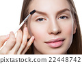 Woman correcting eyebrows form 22448742