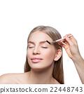 Woman correcting eyebrows form 22448743