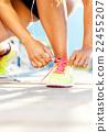 Running shoes - woman tying shoe laces 22455207