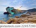 shipwreck or wrecked cargo ship abandoned 22457280