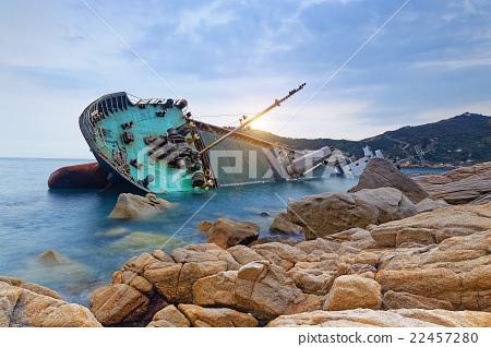 shipwreck or wrecked cargo ship abandoned 22457280
