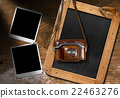 Old Camera with Blackboard and Empty Photos 22463276