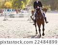Competitor in show jump taking her course 22484899