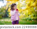 Little kid girl at beautiful autumn park 22490088