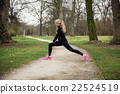 attarcive woman stretching in park 22524519