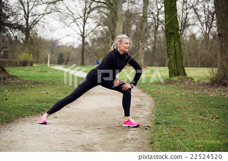 attarcive woman stretching in park 22524520