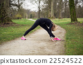 attarcive woman stretching in park 22524522