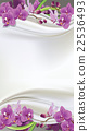 Purple orchids on white silk, fabric background. 22536493