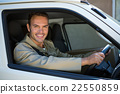 Delivery man driving in his van 22550859