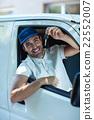 Portrait of smiling delivery man showing car keys 22552007