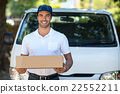 Cheerful delivery person holding cardboard box 22552211