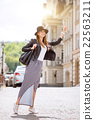 Modern young woman in a big city 22563211