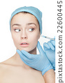 Attractive woman at plastic surgery with syringe 22600445