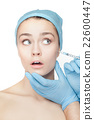 Attractive woman at plastic surgery with syringe 22600447