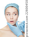 Attractive woman at plastic surgery with syringe 22600450