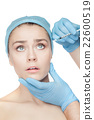 Attractive woman at plastic surgery with syringe 22600519