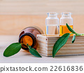Bottle of essential oil with fresh sage leaves . 22616836