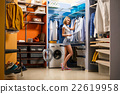 Young woman choosing clothes for husband 22619958