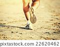 Runner feet running on beach closeup on shoe 22620462