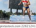 woman athlete runs steeplechase 22621241