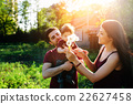 young family with a child on the nature 22627458