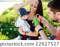 young family with a child on the nature 22627527
