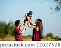 young family with a child on the nature 22627528