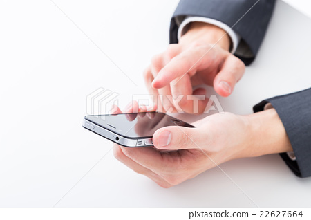 Handjob with smartphone male employee businessman business image investment side job 22627664