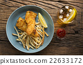 Freshly cooked fish and chips. 22633172