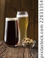 Craft Beer sitting on a rustic wooden bar. 22633354