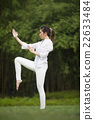 Chinese woman doing Tai Chi outdoors. 22633484