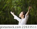 Chinese woman doing Tai Chi outdoors. 22633511