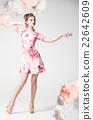 Beautiful elegant model posing in floral printed 22642609