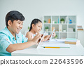 Schoolchildren with digital tablet 22643596