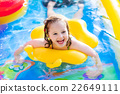 Little girl playing in inflatable garden swimming pool 22649111