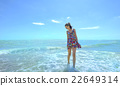 Young smiling woman standing in sea waves 22649314
