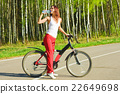 female, outdoors, bicycle 22649698