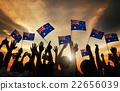 Group of People Waving Australian Flags in Back Lit 22656039