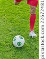 Soccer striker kicking the ball 22672481