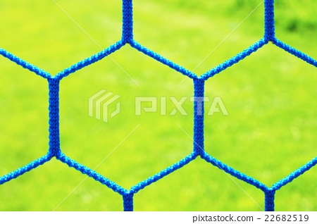 Detail of yellow blue crossed soccer nets 22682519