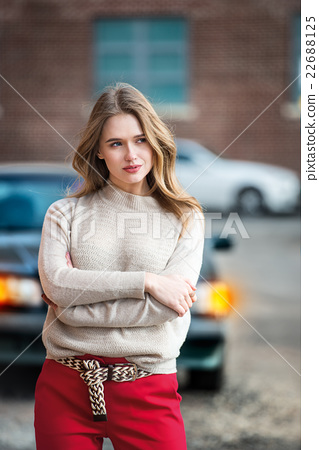 upset woman standing near broken car 22688125
