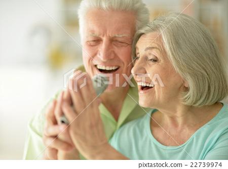 Senior couple with headphones  22739974