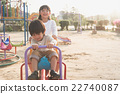 asian child riding seesaw board at the playground 22740087