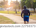 Fit man running and jogging in the park. 22750373