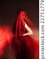 Unrecognizable woman covered with red cloth 22751779