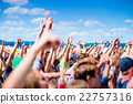 Teenagers at summer music festival clapping and 22757316